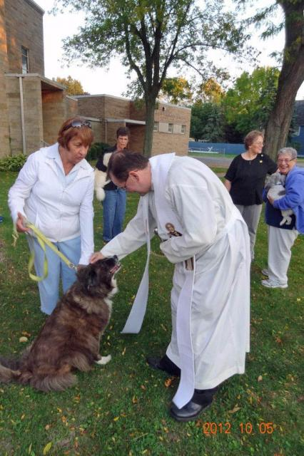 Our pastor greets one of the pets  | Blessed Mary Angela